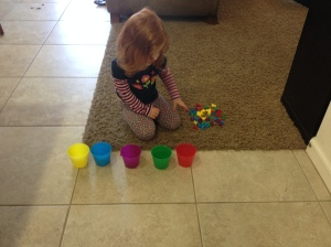 Abby and her bears and their cups. She was sorting, matching, counting, and naming colors. Simply because she had bears and cups.